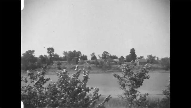 1930s: Lake, trees, hills, houses.