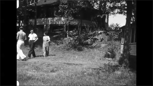 1930s: People walk around house, walk to car, pose in front of car.