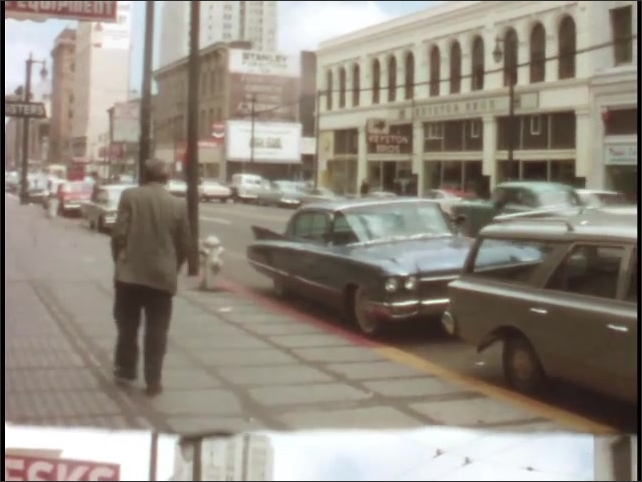 1940s: cars driving past busy road in front of National Cash Register building