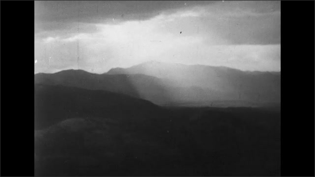 ITALY 1943: Sun Shining Over Mountains in Italy