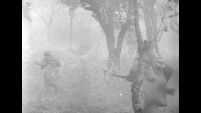 ITALY 1943: Soldiers Running through Fields During Artillery Fire