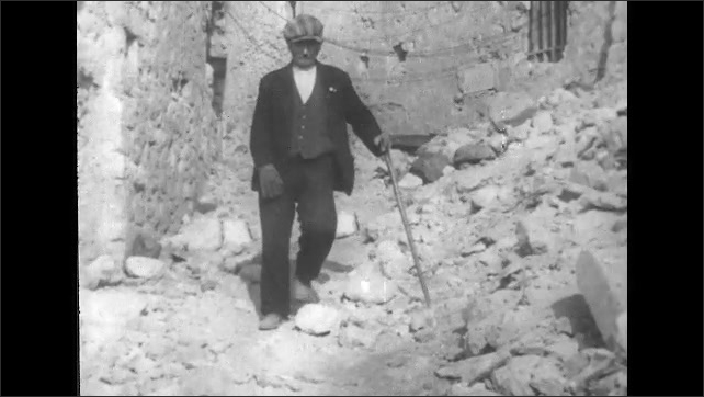 ITALY 1943: Elderly Man and Child Return to Their Home Town of San Pietro After the Battle
