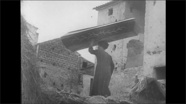 ITALY 1943: Local People Return to their Home in San Pietro Carrying Possessions