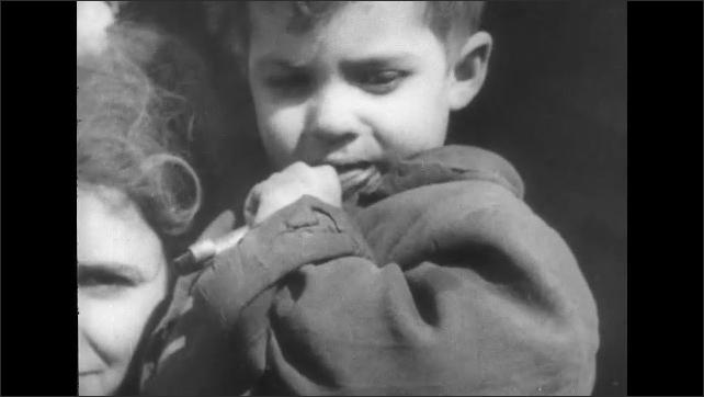 ITALY 1943: Ladies Breastfeeding their Babies Around the Ruins of San Pietro