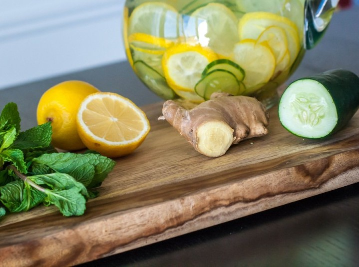 Cucumber Water pitcher with lemons, ginger, and mint leaves.