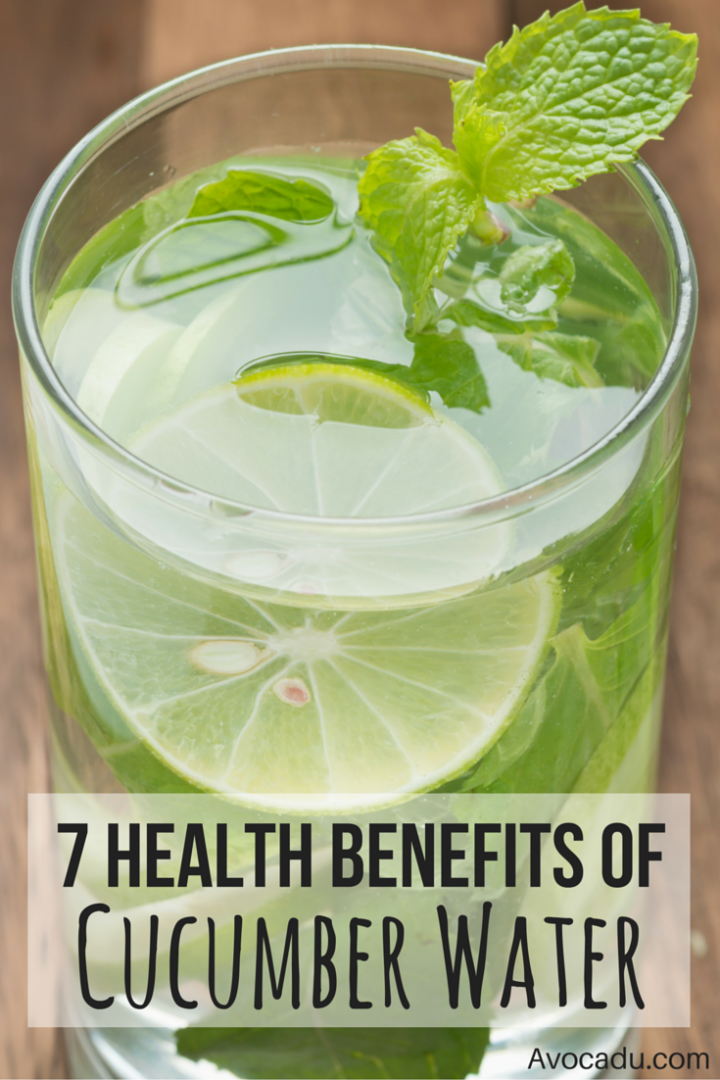 Glass of cucumber water with mint and a lemon