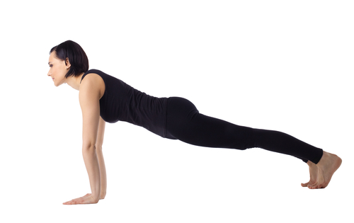 Plank yoga pose for flat abs