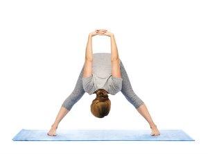 wide legged forward bend yoga pose