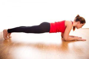 teenage girl exercising to lose weight