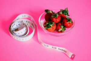 berries and measuring tape