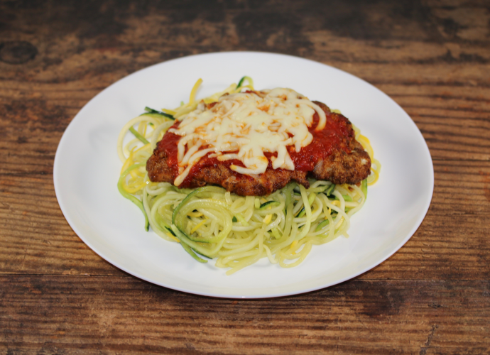 Almond crusted Chicken Parmesan over Zucchini and Summer Squash Noodles