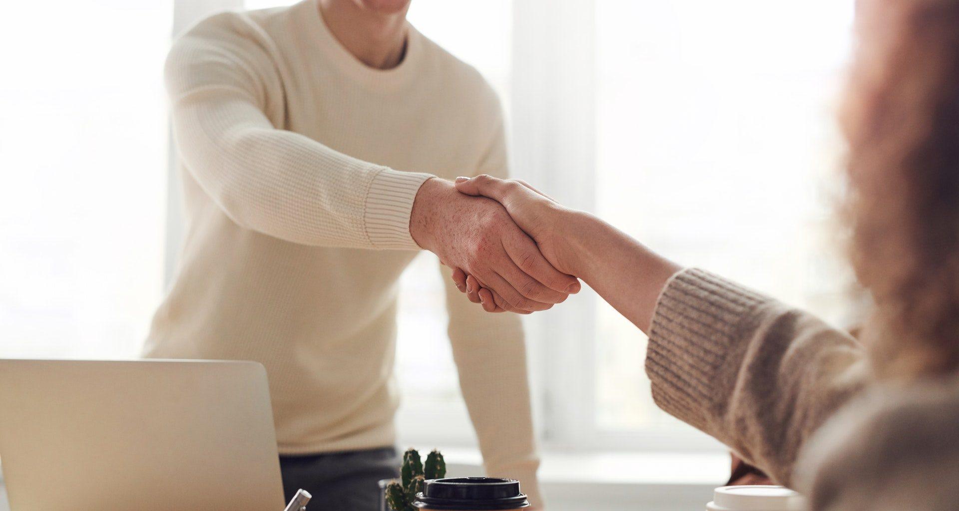 man, woman, shake hands
