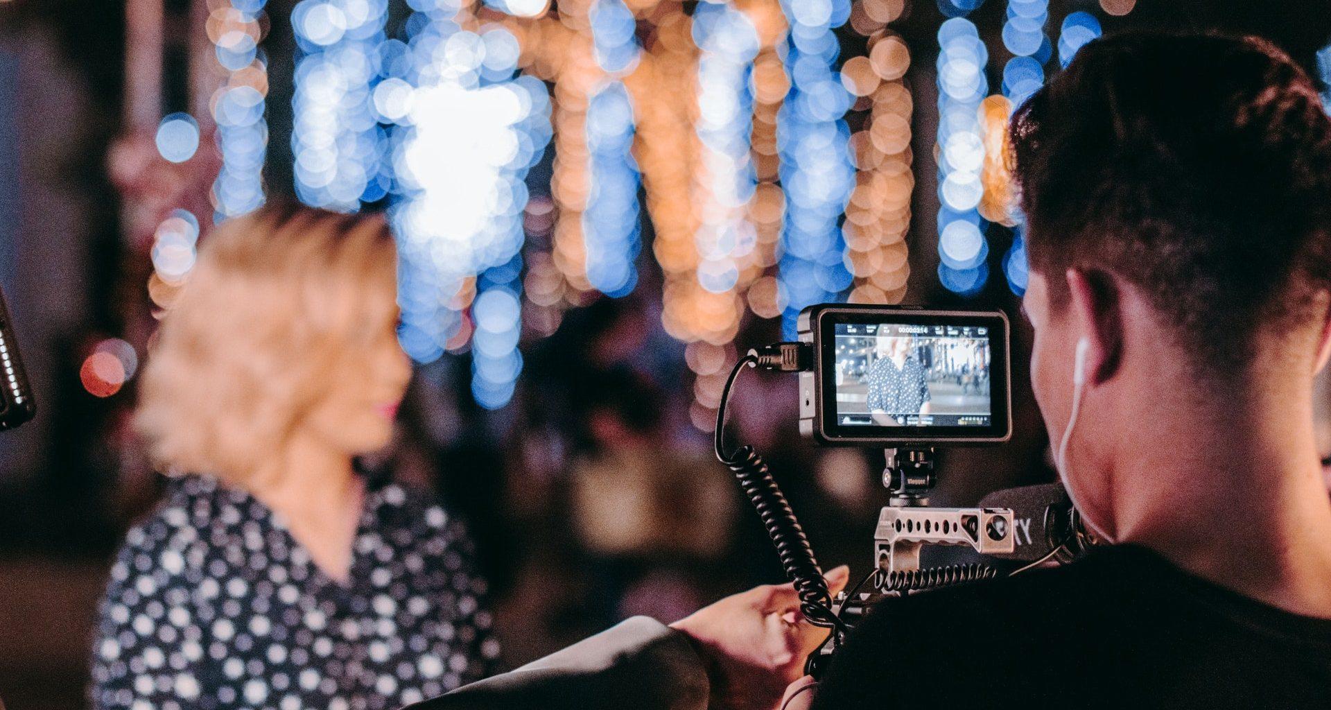 man, video camera