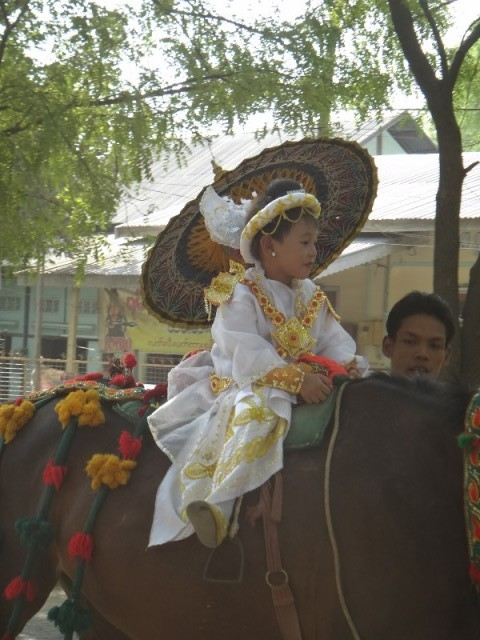 Parade of kids becoming a monk