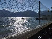 Ochtend zon over het meer bij mijn vertrek.
