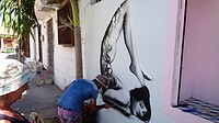 Muurschilderijen is een normale zaak in de wijk Getsemani in Cartagena.