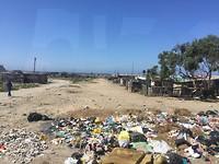 Bergen afval bij de krottenwijken