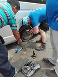 A flat tire on the road to KTM:  we had a fast and efficient repair team on board