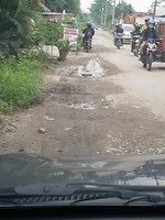 Taxi naar Bukit Lawang, wat een gaten in de weg