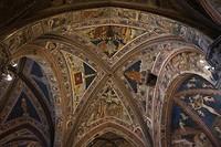 In het Baptisterium, de doopkapel. Je zal als baby omhoog kijken!