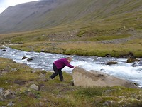 My mum trying to put the rock in the river