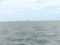 In de verte het marinedok van Den Helder