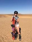 Anna sandboarding in Swakopmund