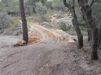 11) Grond verplaatsen om de oprit minder steil te maken