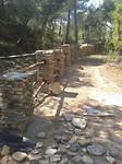 5) Het nieuwe hek in aanbouw