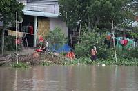 Wassen, afwassen en jezelf wassen in de Mekong.