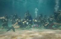 Groepsfoto's op 10 meter diepte zijn de beste groepsfoto's
