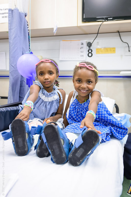 Two children in casts