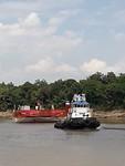 Sleepboot voor transport bruinkool