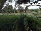 Ons huis vanuit de boomhut