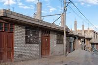 Waar men gaat langs Peruviaanse wegen, daar komt men onafgewerkte huizen tegen...