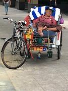 Fiets tuktuk bij Raffles