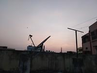 Zonsondergang vanaf dak van appartement..
