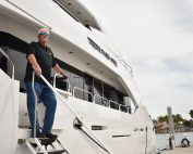 Bill Miller of Algae-X standing on yacht.