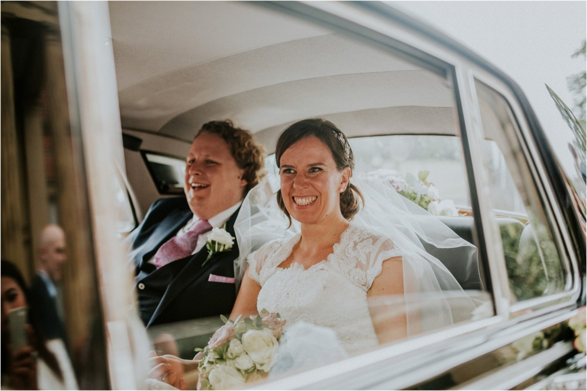 bride and groom arriving in wedding car, Documentary wedding photographer cheshire