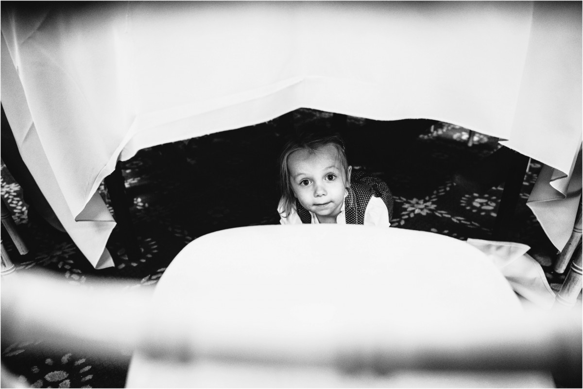 child under table, Documentary wedding photographer cheshire
