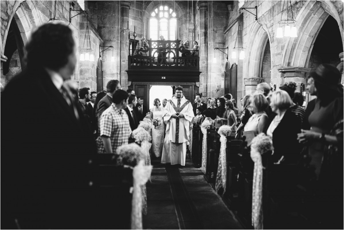 bride entering church, Documentary wedding photographer cheshire
