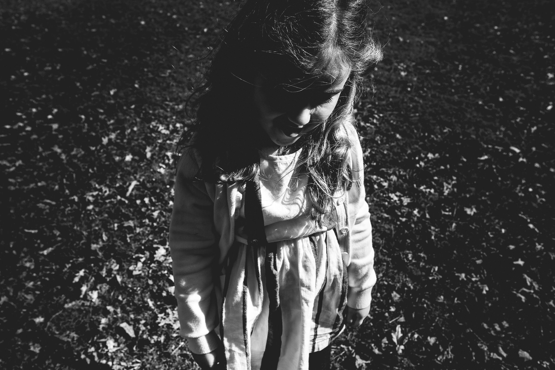 manchester family photographer, dunham massey family photography, ayesha photography, black and white photograph of little girl at dunham massey