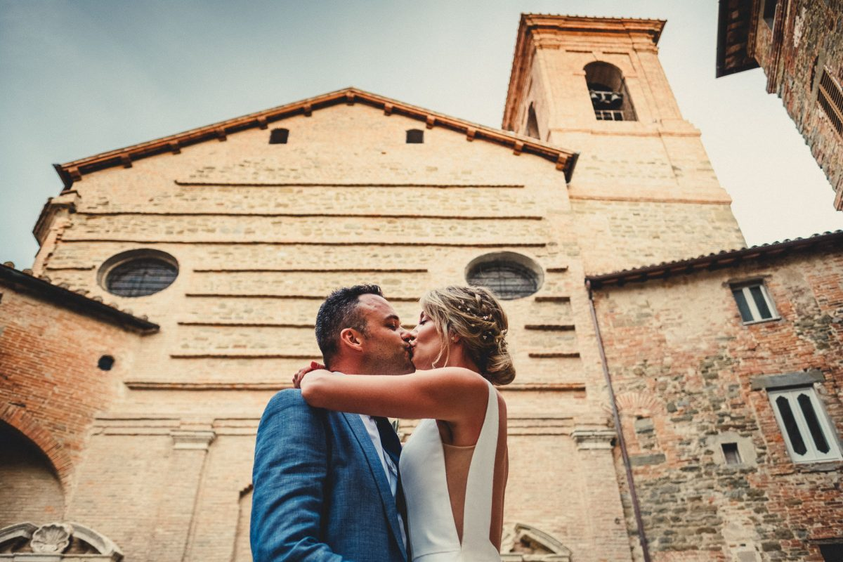Wedding photographer in Umbria, Agriturismo I Frati Paciano, Italian wedding, Ayesha Photography, Destination wedding photography, Italy wedding photographer, Tuscany wedding photographer, Manchester wedding photographer, bride and groom kiss in Panicale outside church