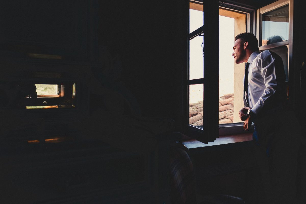 Wedding photographer in Umbria, Agriturismo I Frati Paciano, Italian wedding, Ayesha Photography, Destination wedding photography, Italy wedding photographer, Tuscany wedding photographer, Manchester wedding photographer, groom looking out of window