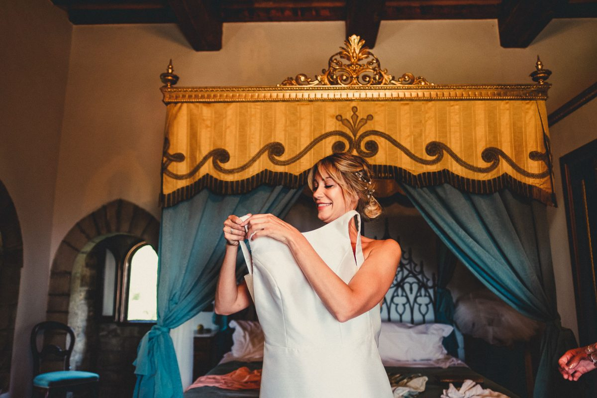 Wedding photographer in Umbria, Agriturismo I Frati Paciano, Italian wedding, Ayesha Photography, Destination wedding photography, Italy wedding photographer, Tuscany wedding photographer, Manchester wedding photographer, bride putting dress on