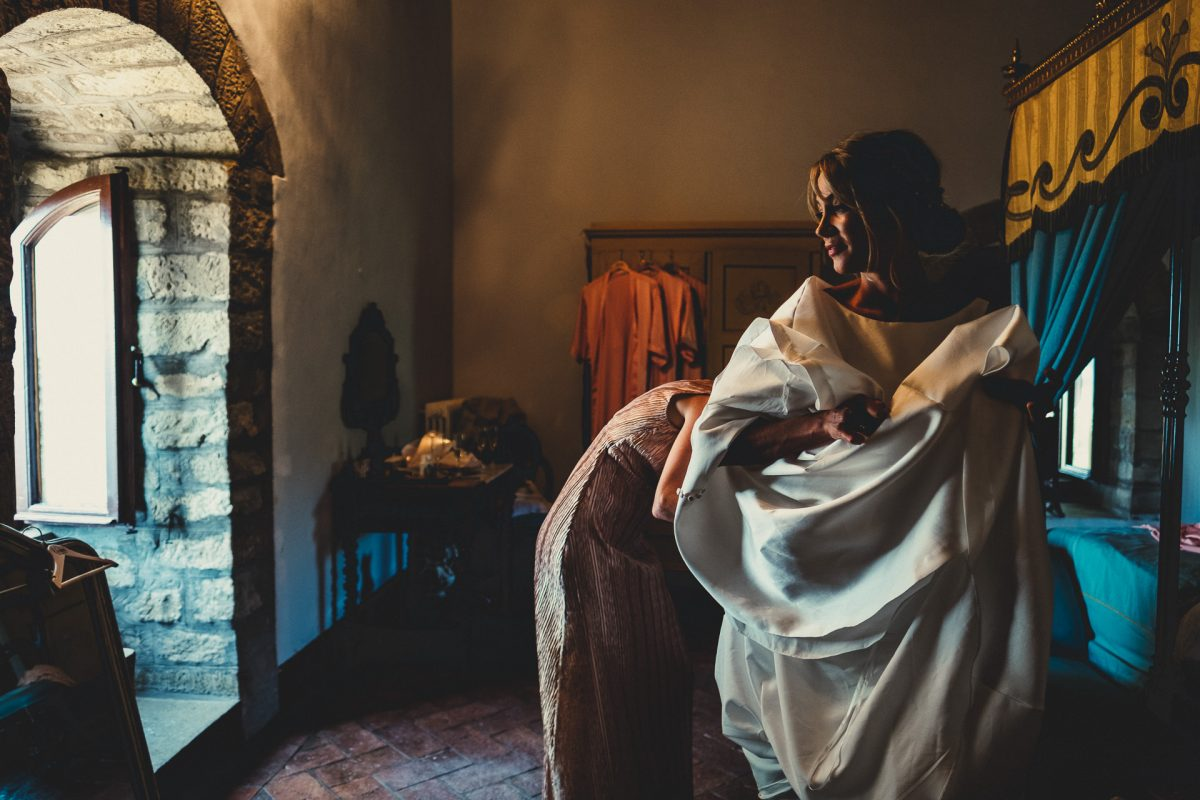 Wedding photographer in Umbria, Agriturismo I Frati Paciano, Italian wedding, Ayesha Photography, Destination wedding photography, Italy wedding photographer, Tuscany wedding photographer, Manchester wedding photographer, bride getting into wedding dress