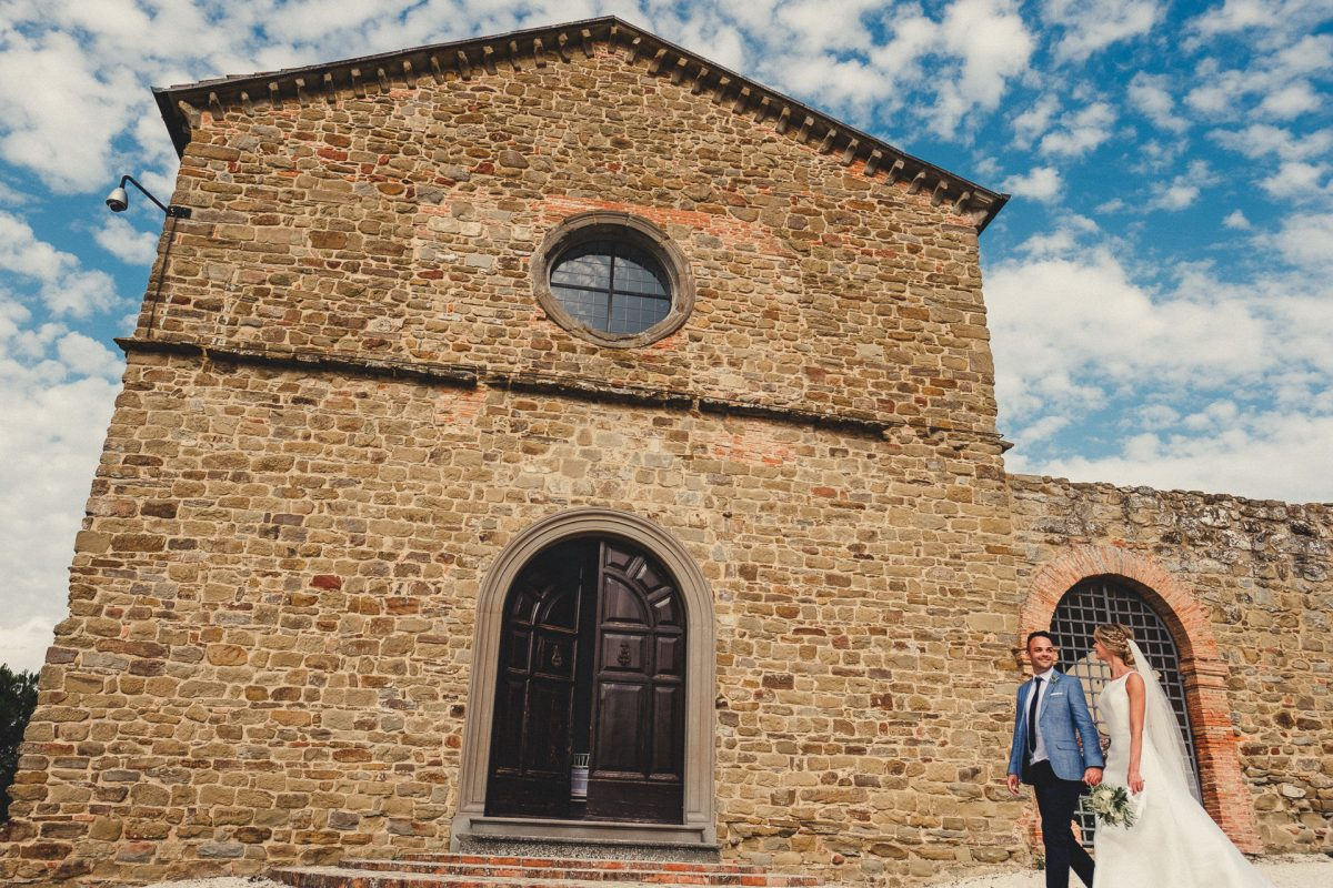 Wedding photographer in Umbria, Agriturismo I Frati Paciano, Italian wedding, Ayesha Photography, Destination wedding photography, Italy wedding photographer, Tuscany wedding photographer, Manchester wedding photographer, bride and groom walk past building