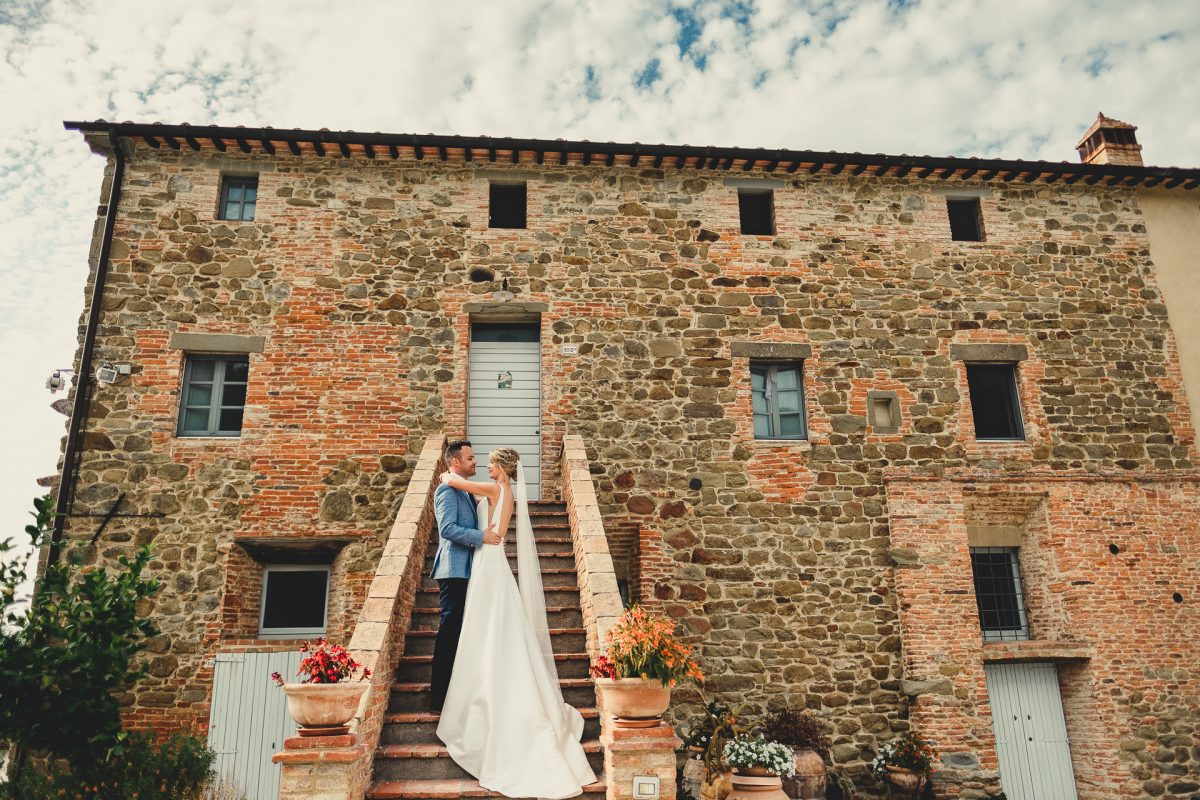 Wedding photographer in Umbria, Agriturismo I Frati Paciano, Italian wedding, Ayesha Photography, Destination wedding photography, Italy wedding photographer, Tuscany wedding photographer, Manchester wedding photographer, bride and groom embrace on staircase