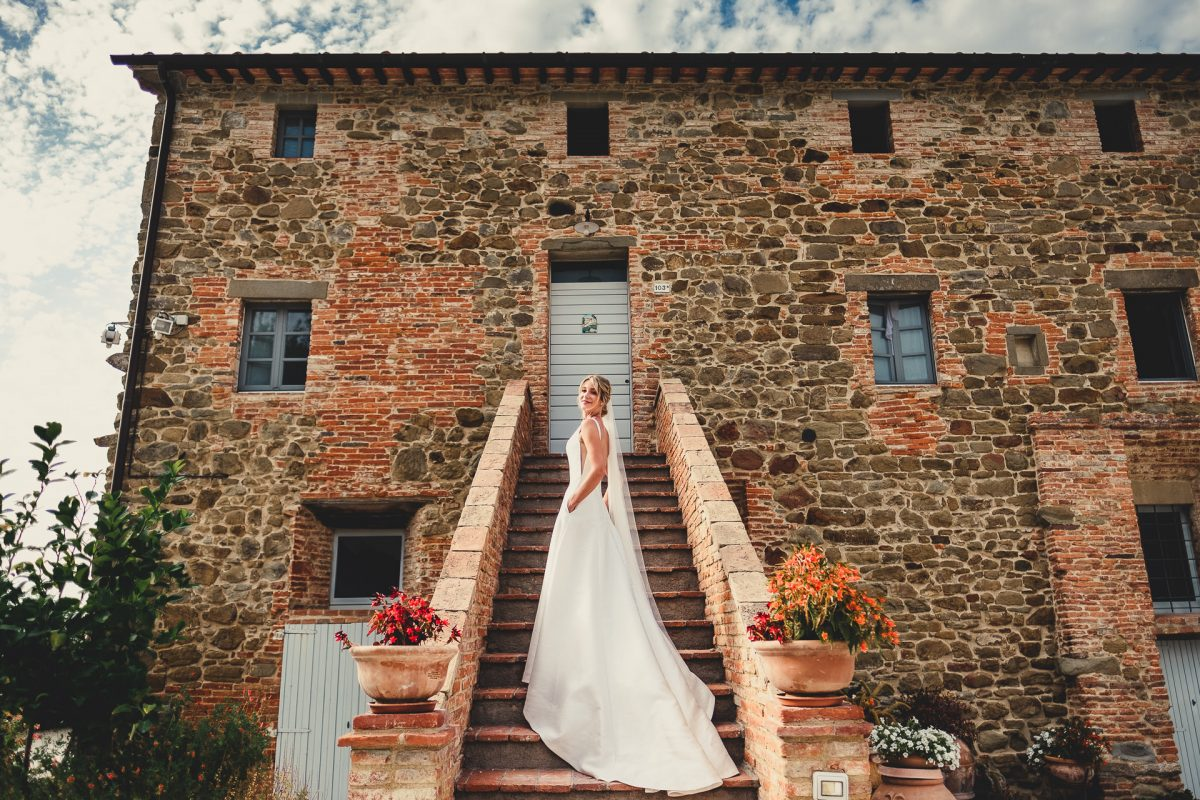 Wedding photographer in Umbria, Agriturismo I Frati Paciano, Italian wedding, Ayesha Photography, Destination wedding photography, Italy wedding photographer, Tuscany wedding photographer, Manchester wedding photographer, bride wears dress with pockets and stands on staircase