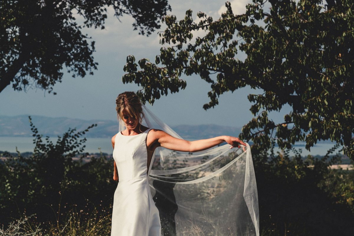Wedding photographer in Umbria, Agriturismo I Frati Paciano, Italian wedding, Ayesha Photography, Destination wedding photography, Italy wedding photographer, Tuscany wedding photographer, Manchester wedding photographer, picture of bride overlooking Lake tresimino